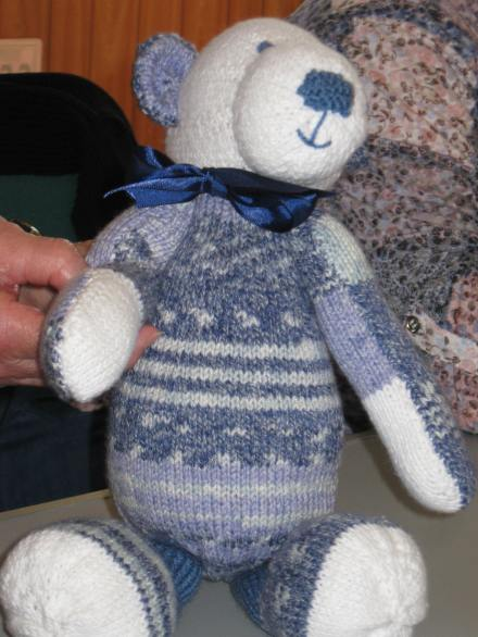 blue and white knitted bear