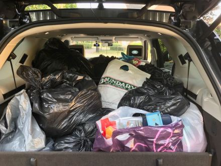 Car loaded with knitted items to be donated to Knit for Peace